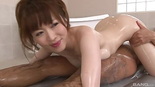 Soapy Japanese enjoys to eat two sticky penises at the same time